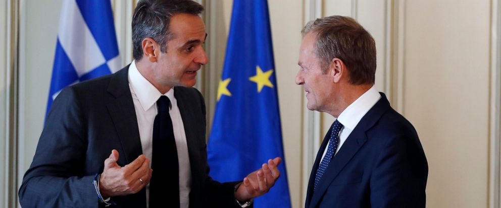 """Greeces Prime Minister Kyriakos Mitsotakis, left, speaks with the European Council President Donald Tusk during their meeting at Maximos Mansion in Athens, Wednesday, Oct. 9, 2019. EU leaders have demanded more """"realism"""" from Britain in response to"""