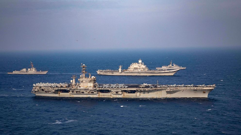 Aircraft carriers and warships participate in the second phase of Malabar naval exercise, a joint exercise comprising of India, US, Japan and Australia, in the Northern Arabian Sea on Tuesday, Nov. 17, 2020. The four countries form the Quadrilateral