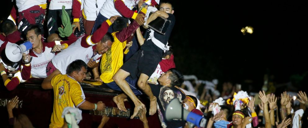 Filipino Roman Catholic devotees jostle to kiss and rub with towels the image of the Black Nazarene in a raucous procession to celebrate its feast day Wednesday, Jan. 9, 2019, in Manila, Philippines. Tens of thousands of mostly barefoot Filipino Cath