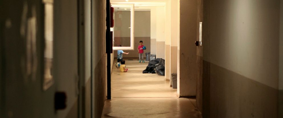 In this photo taken Tuesday, June 11, 2019, children play in the hallway of the abandoned building, now serving as a shelter in the northwestern Bosnian town of Bihac. Aid groups in Bosnia are finding it increasingly difficult to respond to the growi