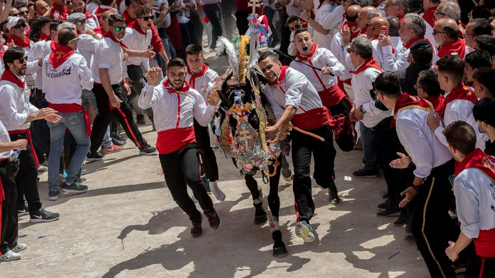 AP PHOTOS: Horses run in centuries-old Spanish fiesta