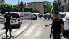 Tunisian police officers stands guard near an explosion site in Tunis, Thursday June 27, 2019. The Tunisian Interior ministry said one police officer has died in the suicide bombing targeting a police patrol in a busy commercial street in central Tun