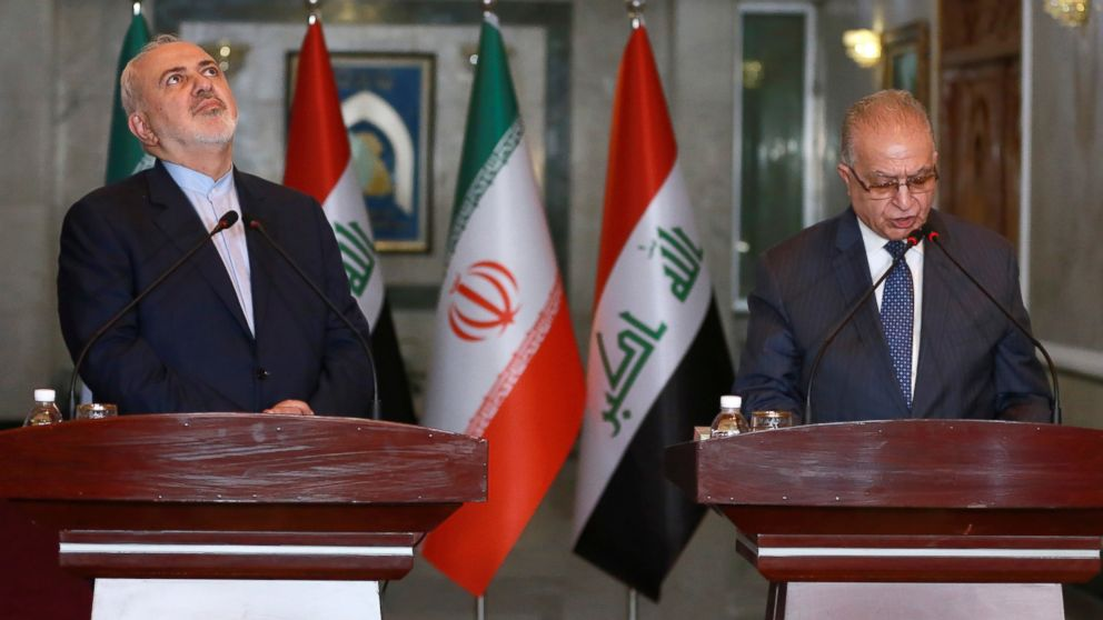 Iraqi Foreign Minister Mohammed Ali al-Hakim, right, and Iranian Foreign Minister Mohammad Javad Zarif, hold a press conference in Baghdad, Iraq, Sunday, Jan. 13, 2019. (AP Photo/Khalid Mohammed)