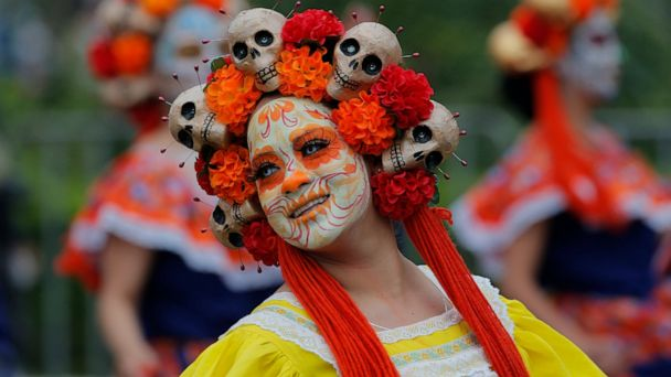 Skulls, masks and dancers as Mexico fetes Day of the Dead