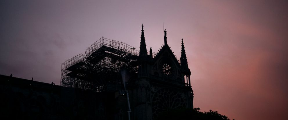 The Notre Dame cathedral is seen on sunrise after the fire in Paris, Tuesday, April 16, 2019. A catastrophic fire engulfed the upper reaches of Paris soaring Notre Dame Cathedral as it was undergoing renovations Monday, threatening one of the greate