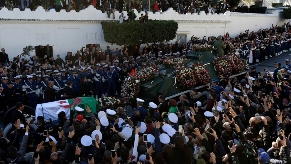 Algeria buries military chief, de facto ruler amid protests thumbnail