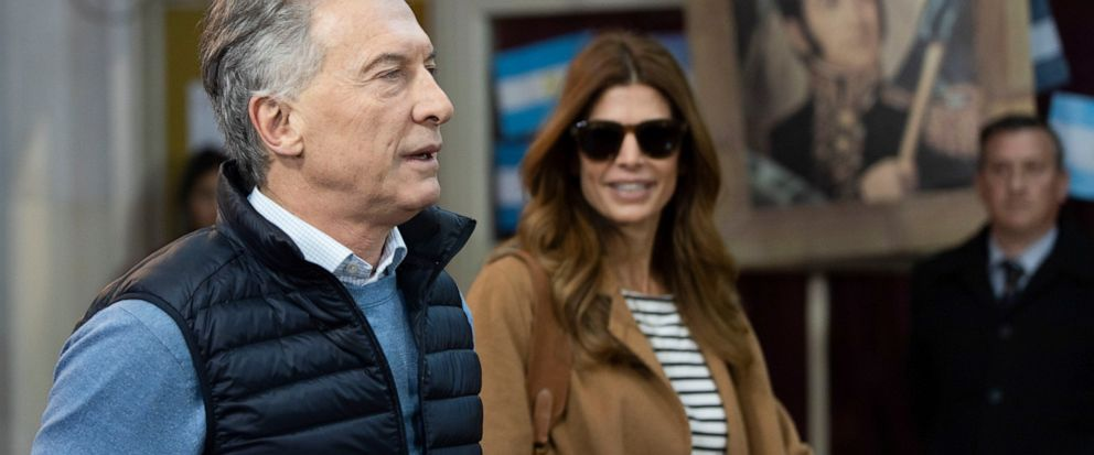 Argentinas President Mauricio Macri accompanied by his wife first lady Juliana Awada, arriveds to cast his vote during primary elections, at a school in Buenos Aires, Argentina, Sunday, Aug. 11, 2019. Macri is running for re-election with the Juntos