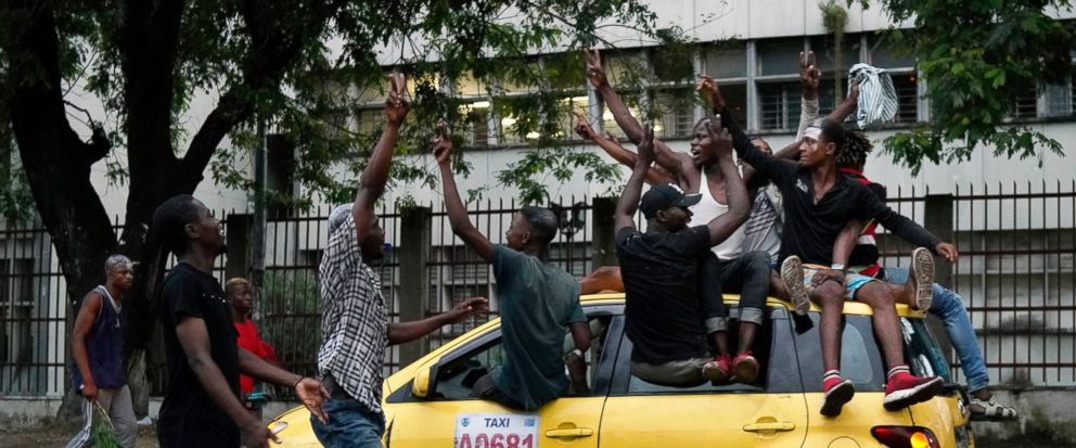 Residents celebrate in Kinshasa Thursday, Jan. 10, 2019, after learning that opposition presidential candidate Felix Tshisekedi had been declared the winner of the elections. (AP Photo/Jerome Delay)