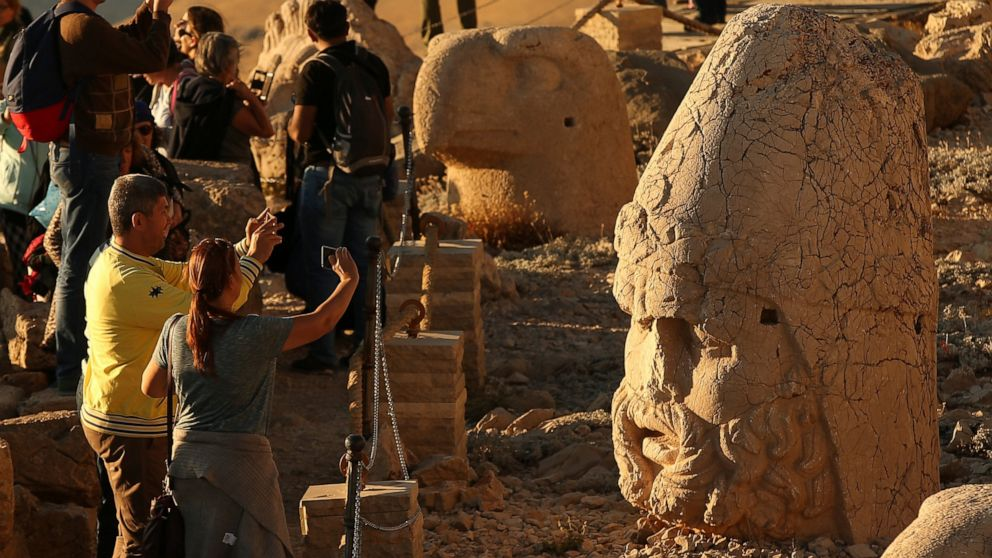 AP PHOTOS: Sunset on Turkey's massive stone heads