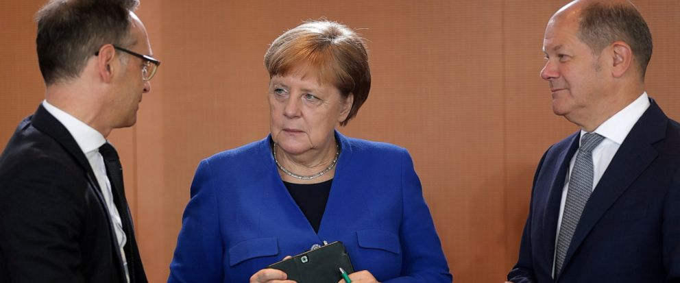 German Chancellor Angela Merkel, center, German Foreign Minister Heiko Maas, left, and German Finance Minister Olaf Scholz talk as they arrive for the weekly cabinet meeting at the chancellery in Berlin, Germany, Wednesday, May 15, 2019. (AP Photo/Mi