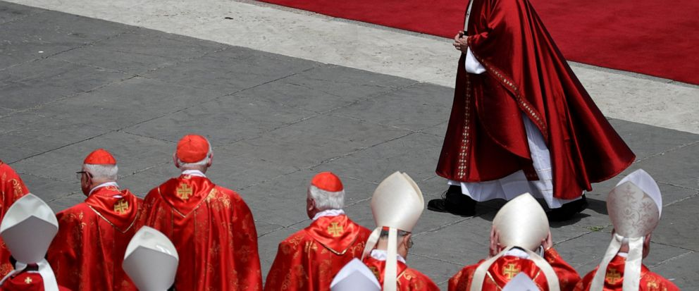 Pope Francis walks past cardinals after celebrating a Pentecost Mass in St. Peters Square, at the Vatican, Sunday, June 9, 2019. The Pentecost Mass is celebrated on the seventh Sunday after Easter. (AP Photo/Gregorio Borgia)
