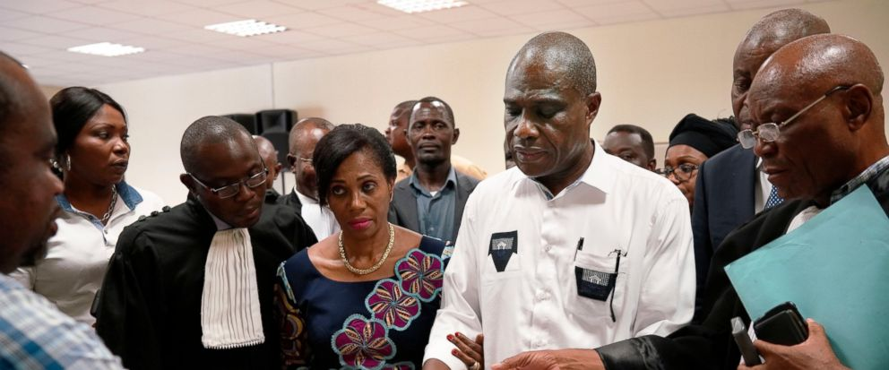 Accompanied by his wife and his lawyers, Congo opposition candidate Martin Fayulu receives the receipt after petitioning the constitutional court following his loss in the presidential elections in Kinshasa, Congo, Saturday Jan. 12, 2019. The ruling