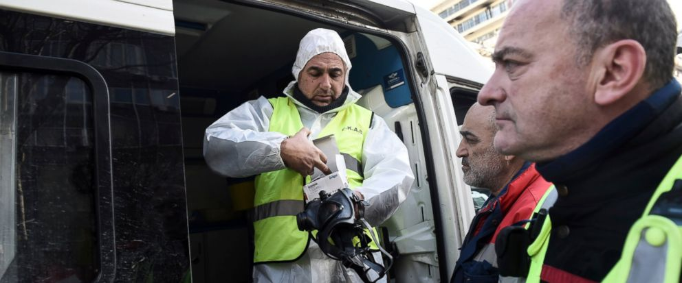 Paramedics prepare to enter a college after employees received a suspicious envelope, in the northern port city of Thessaloniki, Greece, Friday, Jan. 11, 2019. At least nine people have received medical attention after about a dozen letters containin