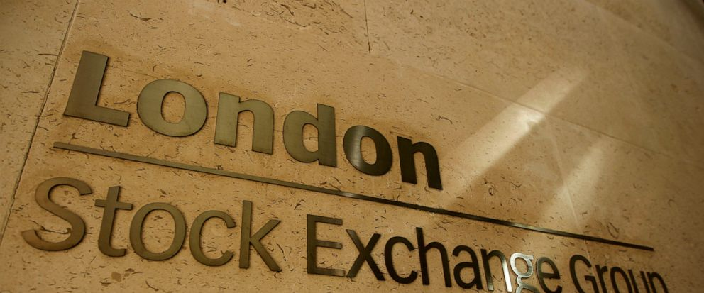 FILE - This Thursday, Sept. 22, 2011 file photo shows a sign outside the Stock Exchange in the City of London. The Hong Kong stock exchange said Wednesday Sept. 11, 2019, it has started talks to buy the London Stock Exchange that would value the Brit