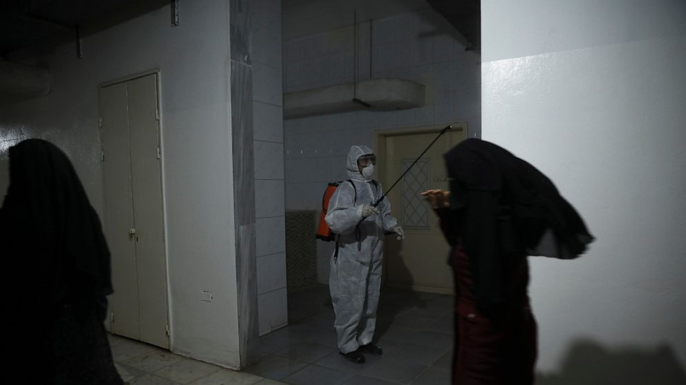 Hospitals in Syria's rebel area reduce services amid virus