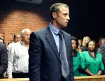 PHOTO: Olympian Oscar Pistorius stands following his bail hearing in Pretoria, South Africa, Feb. 19, 2013.