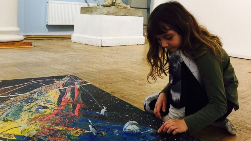 Aelita Andre pictured at the Russian Academy of Fine Arts Museum putting the final touches on her 'Music of the Infinite' exhibit.