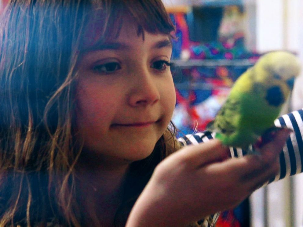 PHOTO: Aelita Andre pictured with Greengrass, one of her pet birds.