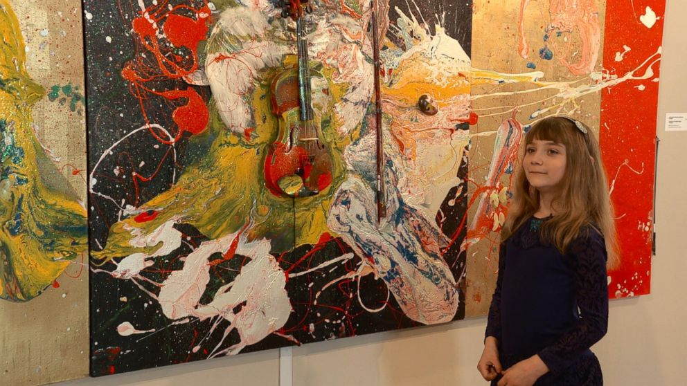 Aelita Andre, 9, is pictured with her art at the Russian Academy of Fine Arts Museum in St. Petersburg, Russia.