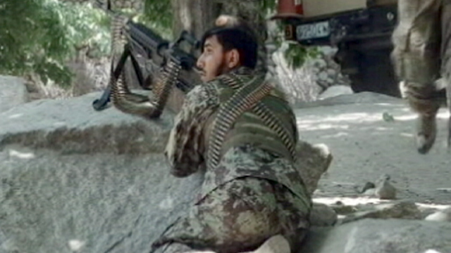 PHOTO: An Afghan soldier is seen during a firefight against the Taliban, July 4, 2012.