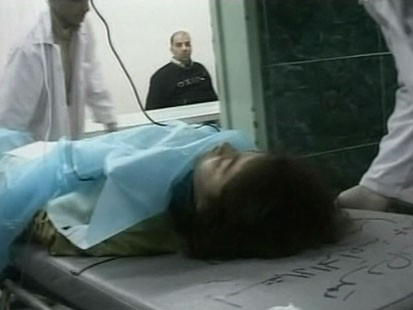 VIDEO: Gazan teenager, badly injured by Israeli shelling, is saved from ruins.