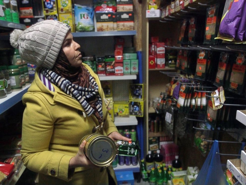 PHOTO: Batoul shops for Syrian goods inside the only Islamic grocery store in Husum, Germany.
