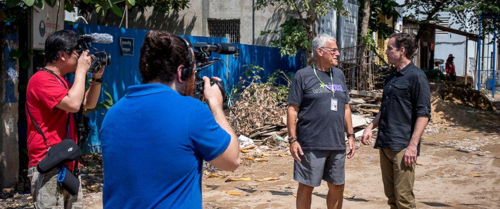 """Nightline"" producers John Kapetaneas and Karson Yiu film ABCs Bob Woodruff interview Don Brewster in Cambodia."
