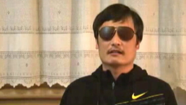 PHOTO: Guangcheng, a 40-year-old human rights activist who has campaigned for disabled rights and against forced abortions, scaled a wall and slipped past around 100 security guards surrounding his house.