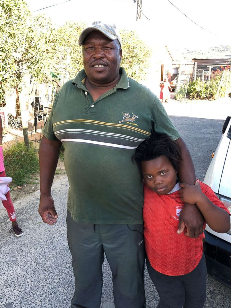 Julius Mulefe is seen here with one of his daughters. Hes lived in a Cape Town township for 24 years.