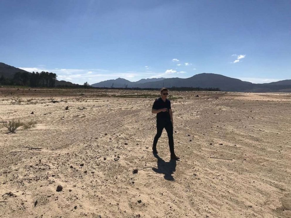 ABCs James Longman at the Theewaterskloof dam, which is only 12.5 percent full as of Feb. 2018.