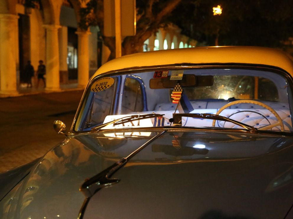 PHOTO A Cuban Taxi Sits Empty With An American Flag Air Freshener Inside On August