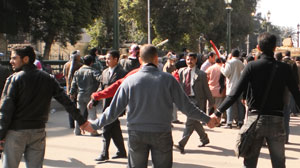PHOTO Protesters in Cairo, Egypt formed a human line defense to keep out trouble makers.