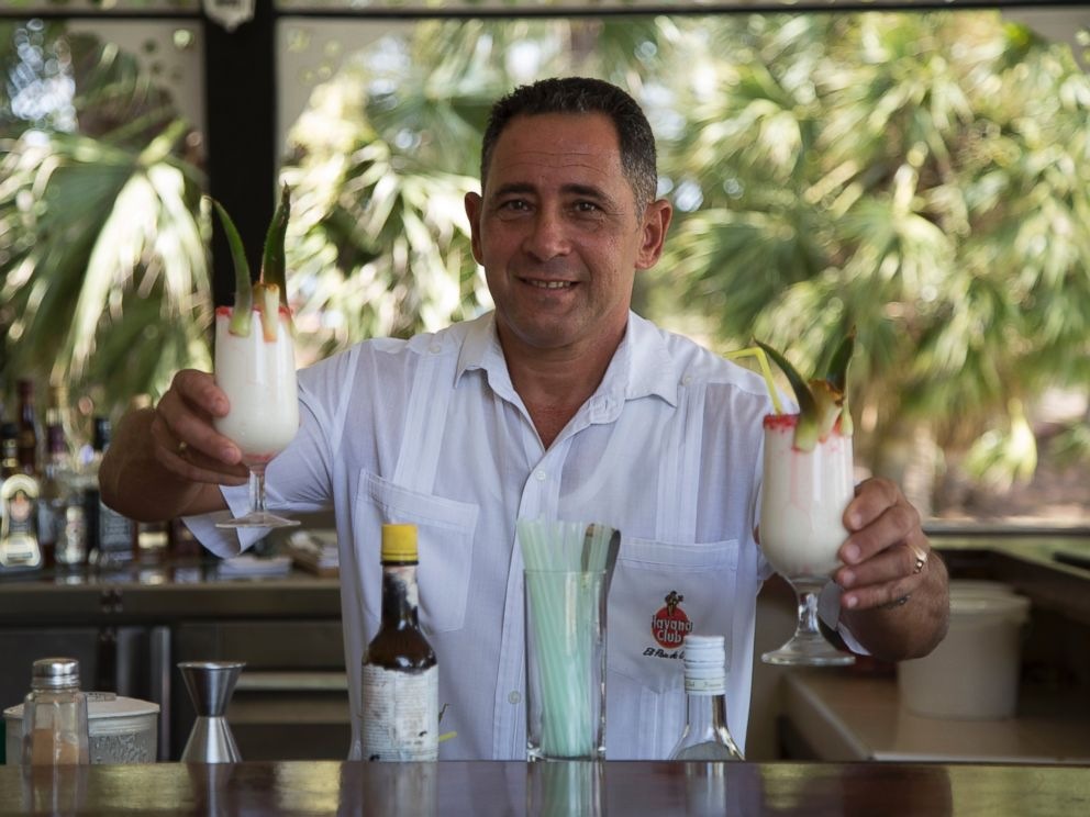 PHOTO: Juan Miguel, Elians father, serves up Pina Coladas at his job as a bartender - the same job he had before the US/Cuba custody battle.
