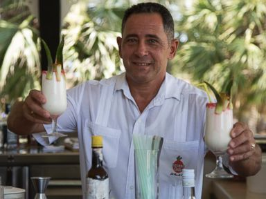 PHOTO: Juan Miguel, Elians father, serves up Pina Coladas at his job as a bartender - the same job he had before the US/Cuba custody battle.