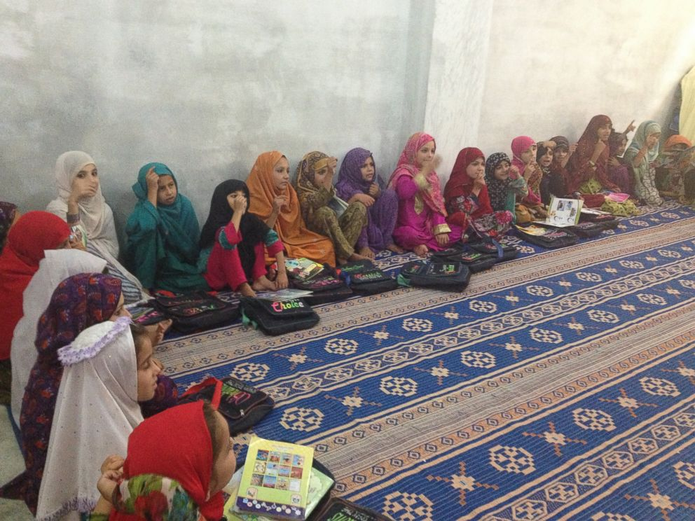 PHOTO: Some of the youngest students at Jamia Hafsa. Most of these girls live in the madarssa and sleep and study in this room. These girls are young enough that ABC News was allowed to photograph them without the full veil known as niqab.