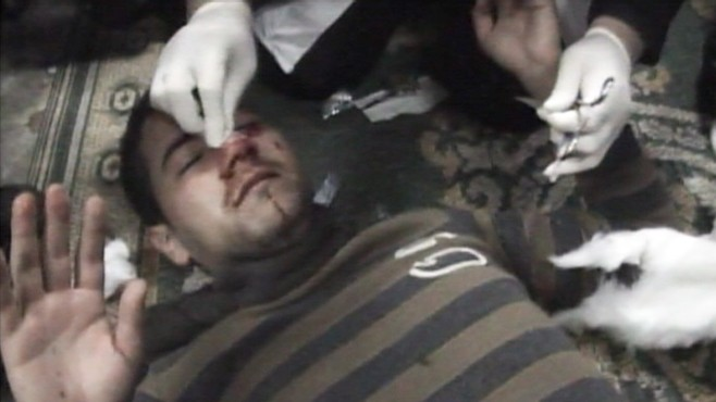 VIDEO: A mosque in Cairo becomes a makeshift clinic to treat wounded protesters.