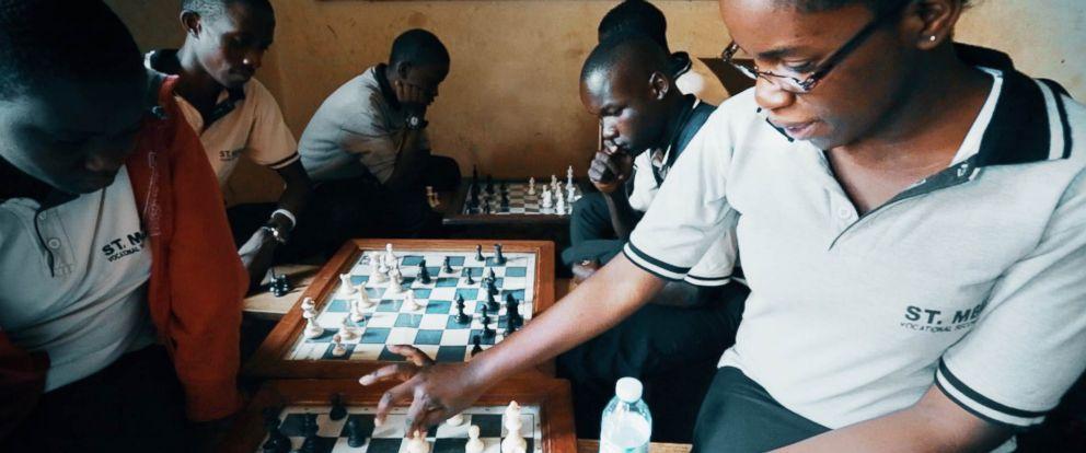 PHOTO: Phiona Mutesi, 20, plays chess at the SOM Chess Academy in Katwe, Uganda.
