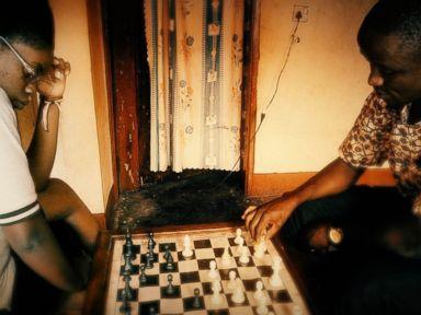 PHOTO:Phiona Mutesi and Robert Katende playing chess at the SOM Chess Academy.