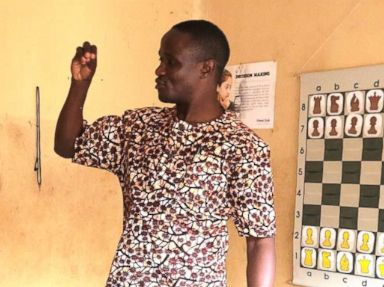 PHOTO: Robert Katende teaching a class at the SOM Chess Academy in Katwe, Uganda.