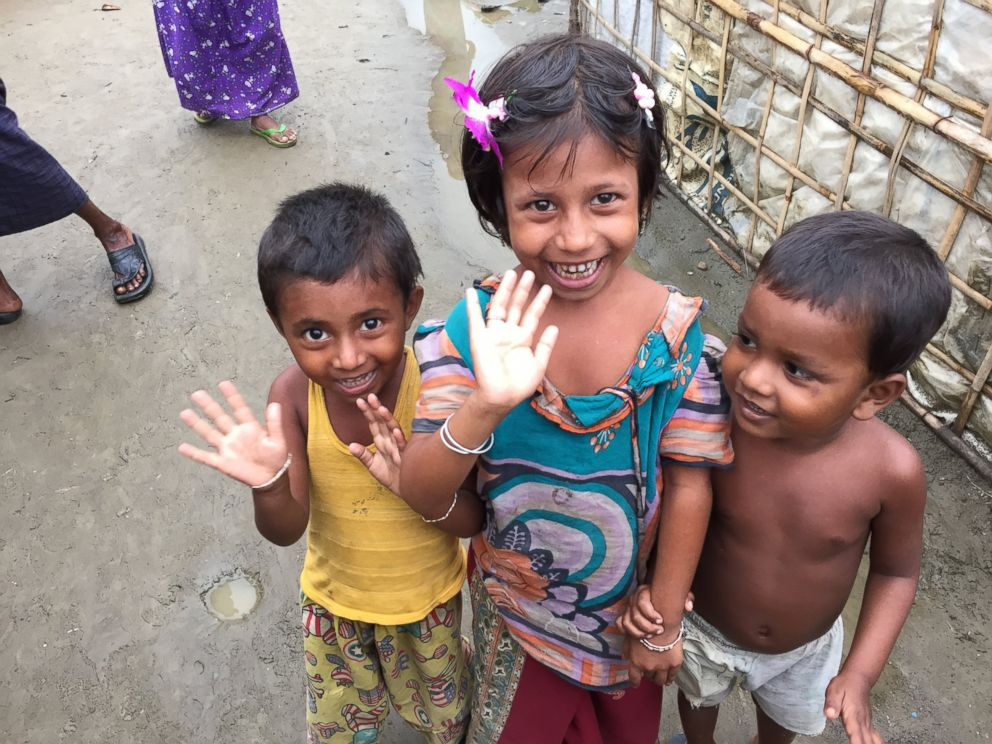 PHOTO: Young Rohingya children wave to the camera at a refugee camp outside of Sittwe, Myanmar.