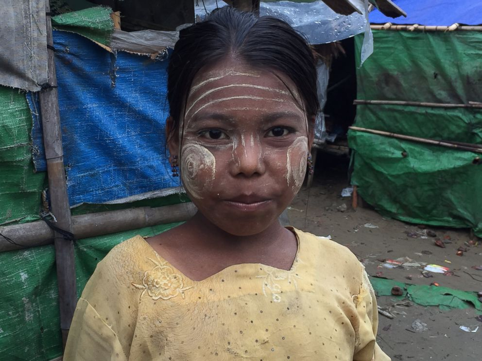 PHOTO: A young Rohingya girl living in a refugee camp outside of Sittwe, Myanmar, wears Thanakha on her face to protect her skin.