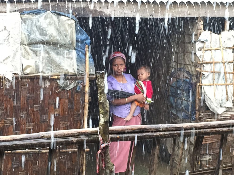 PHOTO: A young Rohingya woman and child in the rain.