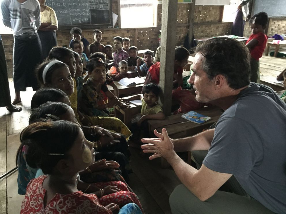 PHOTO: ABC News Bob Woodruff speaking with young children inside the refugee camps outside of Sittwe, Myanmar.