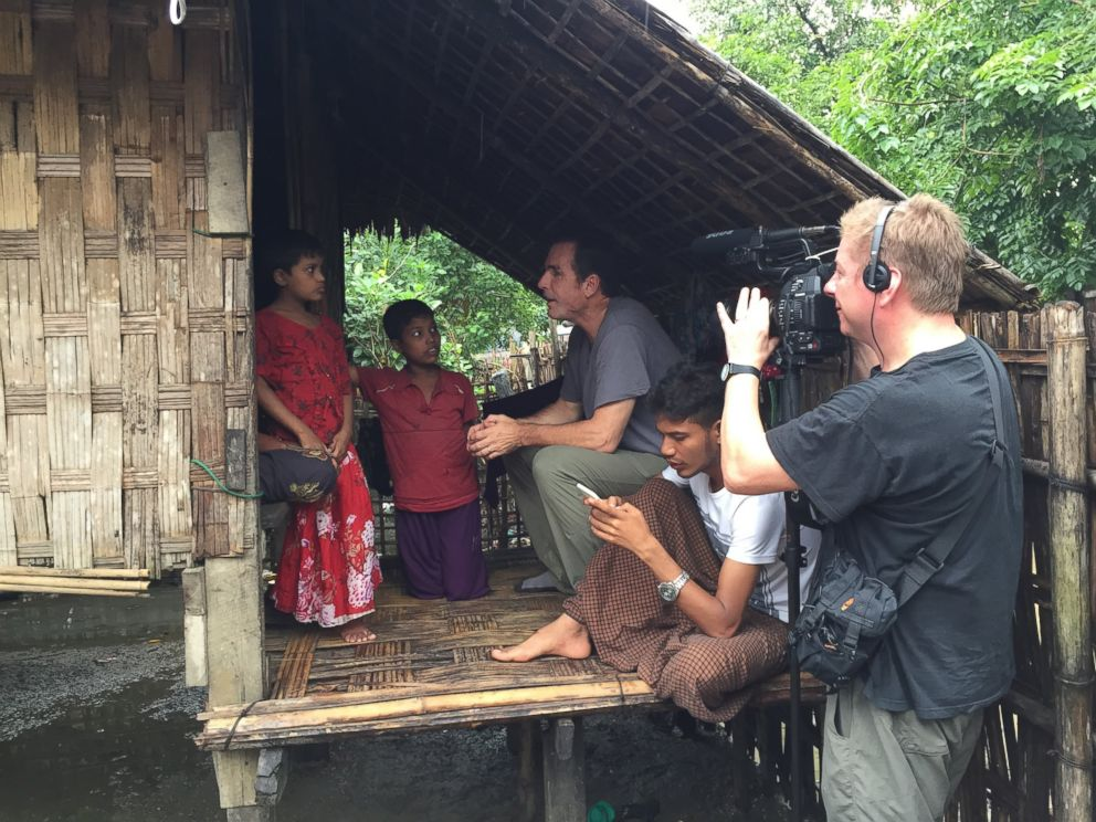 PHOTO: ABC News Bob Woodruff and cameraman Sean Keane interview a woman and her children inside the refugee camps outside of Sittwe, Myanmar.