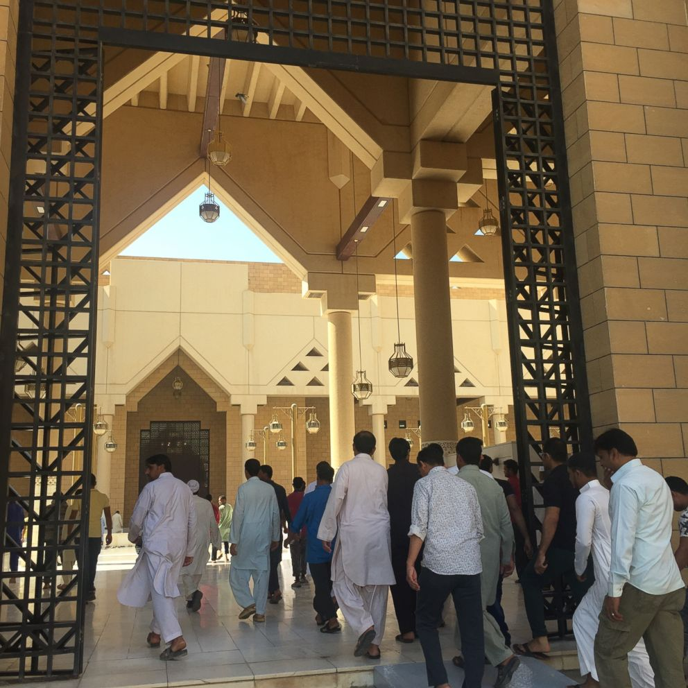 Men stream into the Grand Mosque in Riyadh for Friday Prayers.