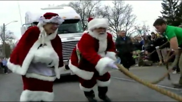 VIDEO: Dressed as Santa, the Rev. Kevin Fast breaks a world record for pulling the heaviest sleigh.