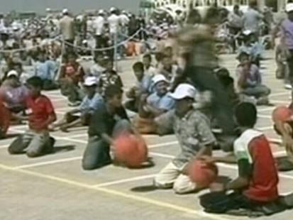 Video: Gazans attempt to break basketball bouncing record.