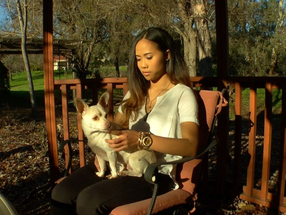 Sokha Chan, 22, is shown here with her dog during an interview with ABC News Nightline.