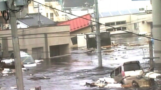 VIDEO: Raw footage from Japan captures the tsunami hitting a town in Miyagi.