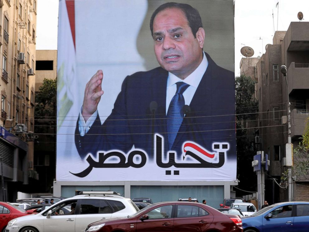 PHOTO: Cars pass by a poster of Egypts President Abdel Fattah al-Sisi for the upcoming presidential election, in Cairo, Egypt, Feb. 19, 2018. The writing on the poster reads: Long live Egypt.